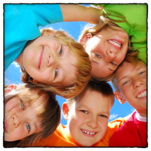 Bright Kids in Circle Sky Background